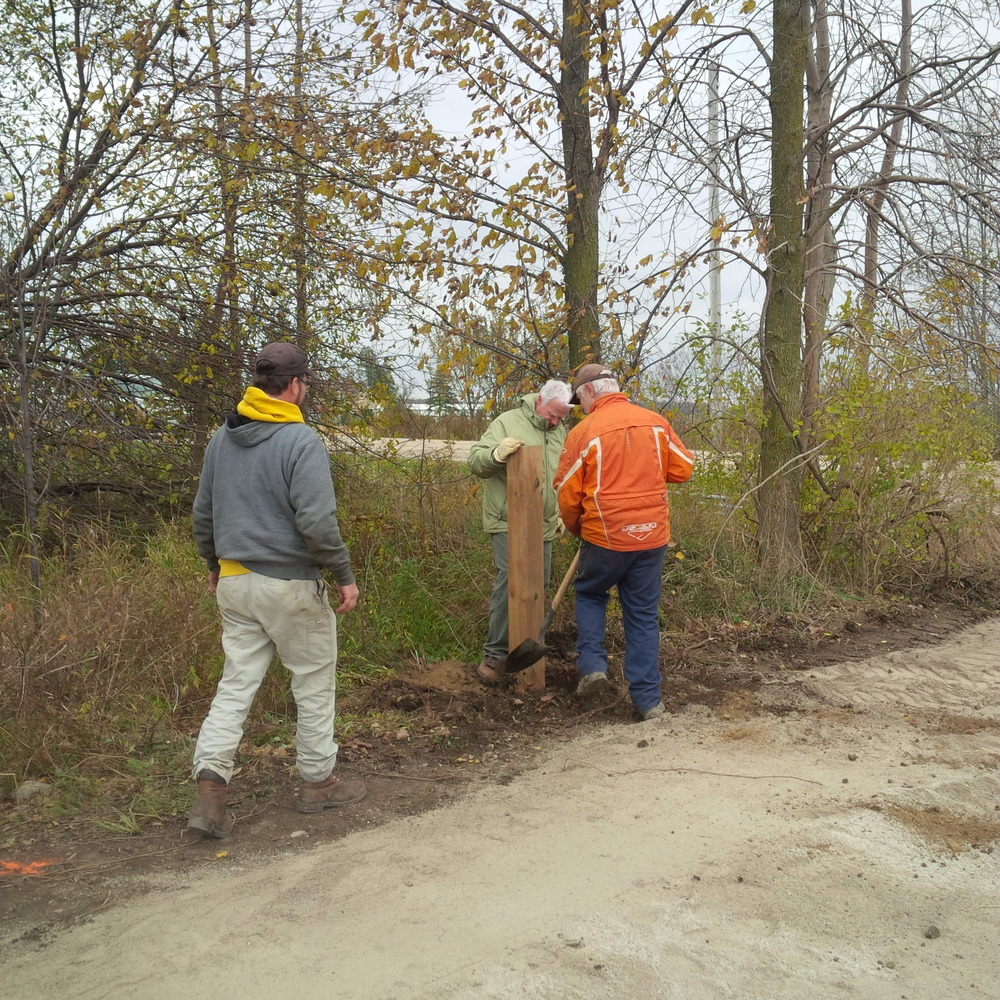 Joe, Doug and Chris set a pole for one of the gates erected on both ends of the 2 km section of trail.
