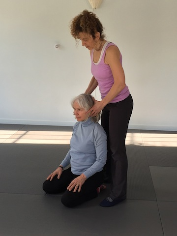 Aging gracefully: Katie helps a student rediscover        the natural poise of the head in sitting