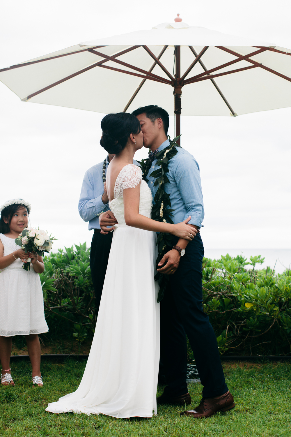 First Kiss | Boho Chic Oahu Beachfront Wedding | Michelle Garibay Events