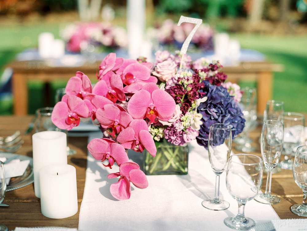 Michelle Garibay Events | Elegant Oahu Wedding | Loulu Palm Estate | Destination Wedding Planner | Purple Orchid Centerpiece