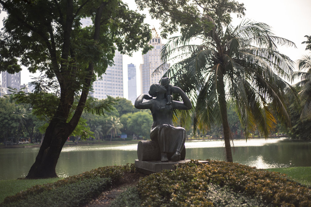 "Sculpture entitled ""A Mother's Love"" in Lumphini Park. Built in 1992 as a youth project in commemoration of the Queen's 60th birthday. It made me miss my mom."