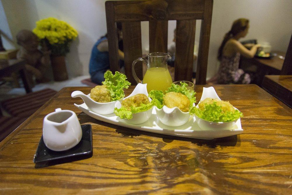 Fried dumplings on lettuce.