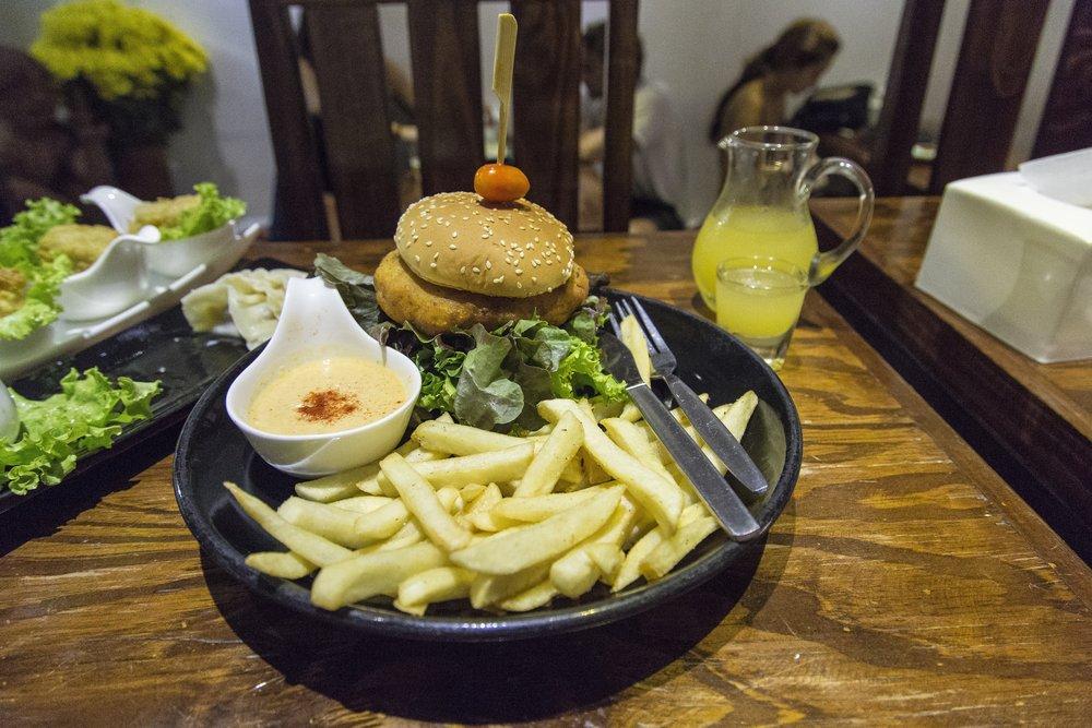 Mango falafel burger with fries and a garlicy vegan aioli.