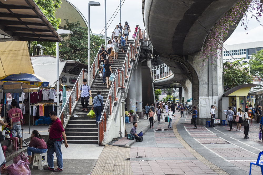 Stairs from the Skytrain leading into Victory Point Market.