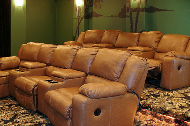 Plush seats with drinks holders offer perfect comfort   for movie watching