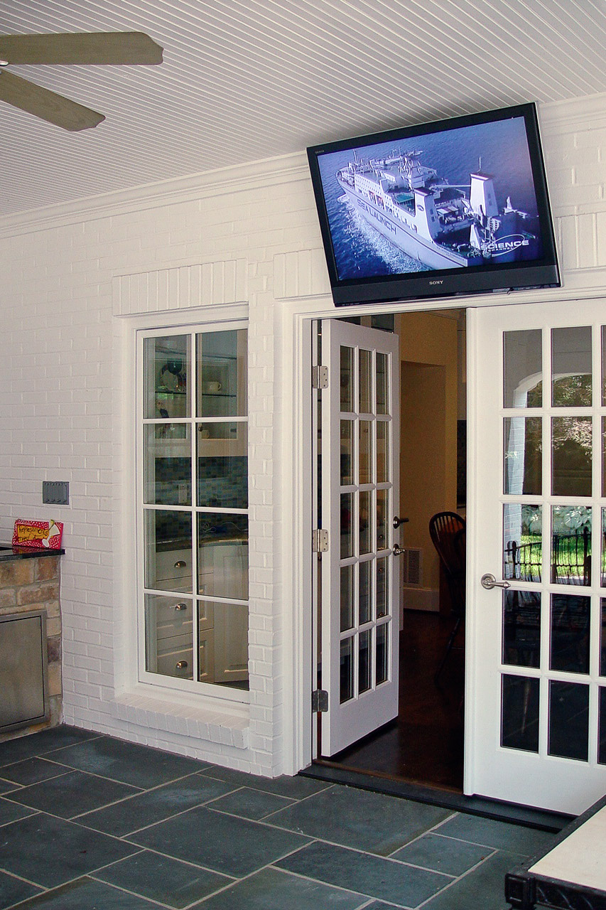 Preston Hollow, Dallas, Texas  This large outdoor television is controlled by an in-wall color touchscreen.  From the touchscreen, the homeowner can access the audio/video system, and the home CCTV security cameras.  Weekend games can be enjoyed from the outdoor kitchen.  When the front doorbell rings, the camera displays on the TV, showing the homeowners who's just arrived.
