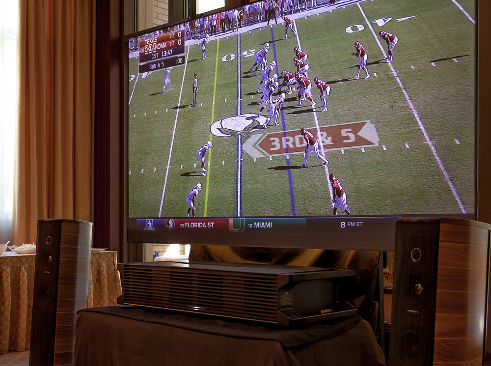 We set up this game-day system for The Ritz-Carlton Residences.  We used a short-throw projector, and a Black Diamond projector screen.
