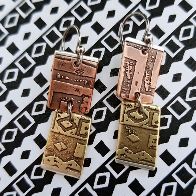 These Tile Stack Earrings have been on the line for years - but with new pattern combinations at play they seem fresh.  Come check out all my new earrings at the #portlandsaturdaymarket TOMORROW! . . . . . . . #portlandsatmarket #portlandhandmade #artisanjewelry #contemporaryjewelry #pdxmaker #finejewelry #jewelry #jewelrydesign #textile #metalsmith #metaljewelry #mixedmetal #artisan #handcraftedjewelry #handmadejewelry #whatsonmybench #benchjeweler #jewellry #women #artist #lovemyjob #copperjewelry #silver #etching #design #portland #studiojeweler #fashion