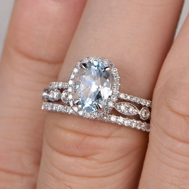 Absolutely GORGEOUS #aquamarine wedding set in white gold - love the delicate diamond accents and claw prongs.