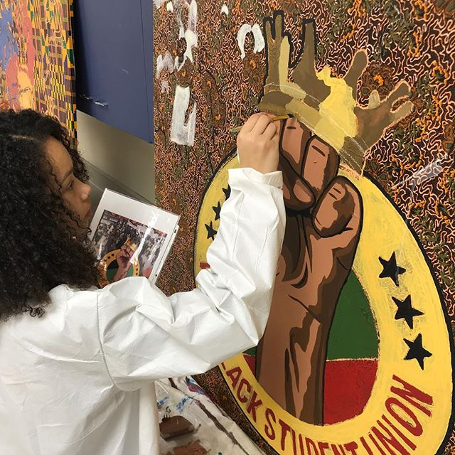 Painting with Verona Area High School Students (Black Student Union). The four 4x4ft panels depict the Past (Africa) and the Present (here) imageries. This is the first time we are exploring painting a mural on African fabric. The Nigerian fabrics are glued to the panels and one coat of Varathane applied to protect the fabric from accidental spills while the students paint. A top coat will be applied when finished. The panels will be displayed at the current high school, and will be moved to the new high school in Fall 2020. #danearts #murals