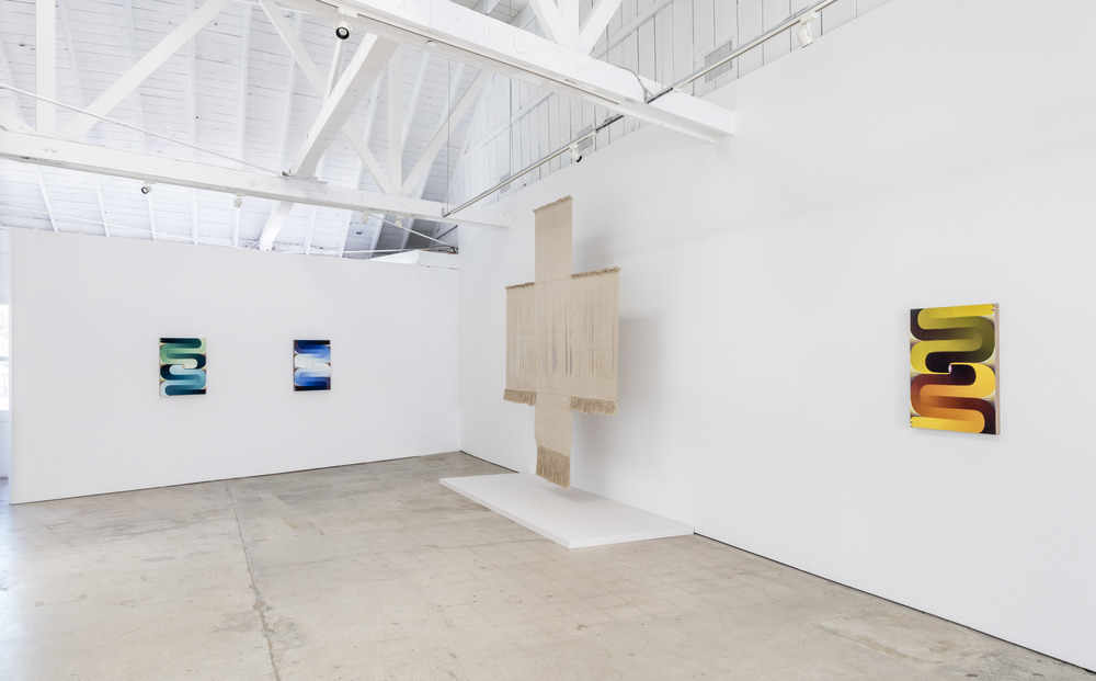 Paintings hung alongside Lenore Tawney fiber art at the Landing in Los Angeles, CA