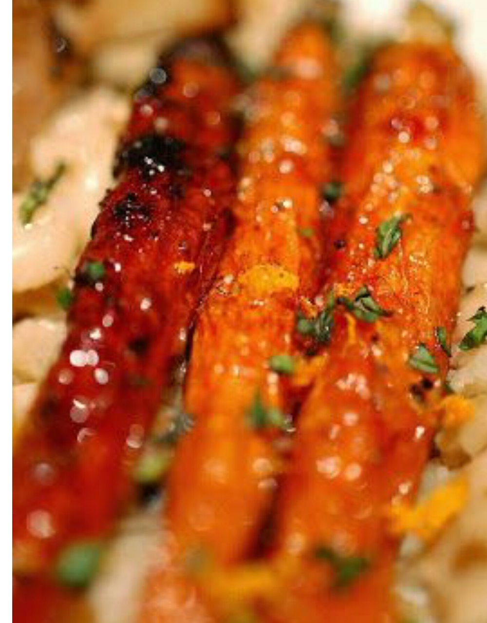 Electric carrots  2lbs youngcarrots peeled  3 cloves garlic rough chop  3T Olive oil  1/2 jar warmed EBRC  Sea salt and fresh thyme  350 oven  In a bowl toss warmed EBRC oil garlic and carrots  Place glazed carrots in a roasting pan  Oven 20 to 30 min till carmalized and roasted ...your nose will know... Then after placing on serving platter sprinkle fresh chopped thyme and a sprinkle of sea salt to taste...