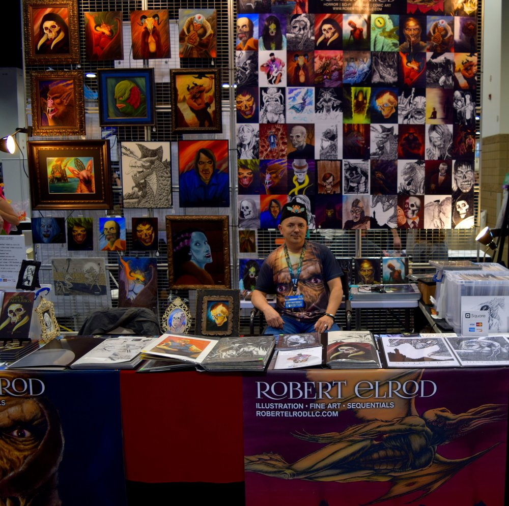 Robert Elrod with his art at Denver Comic Con 2016.