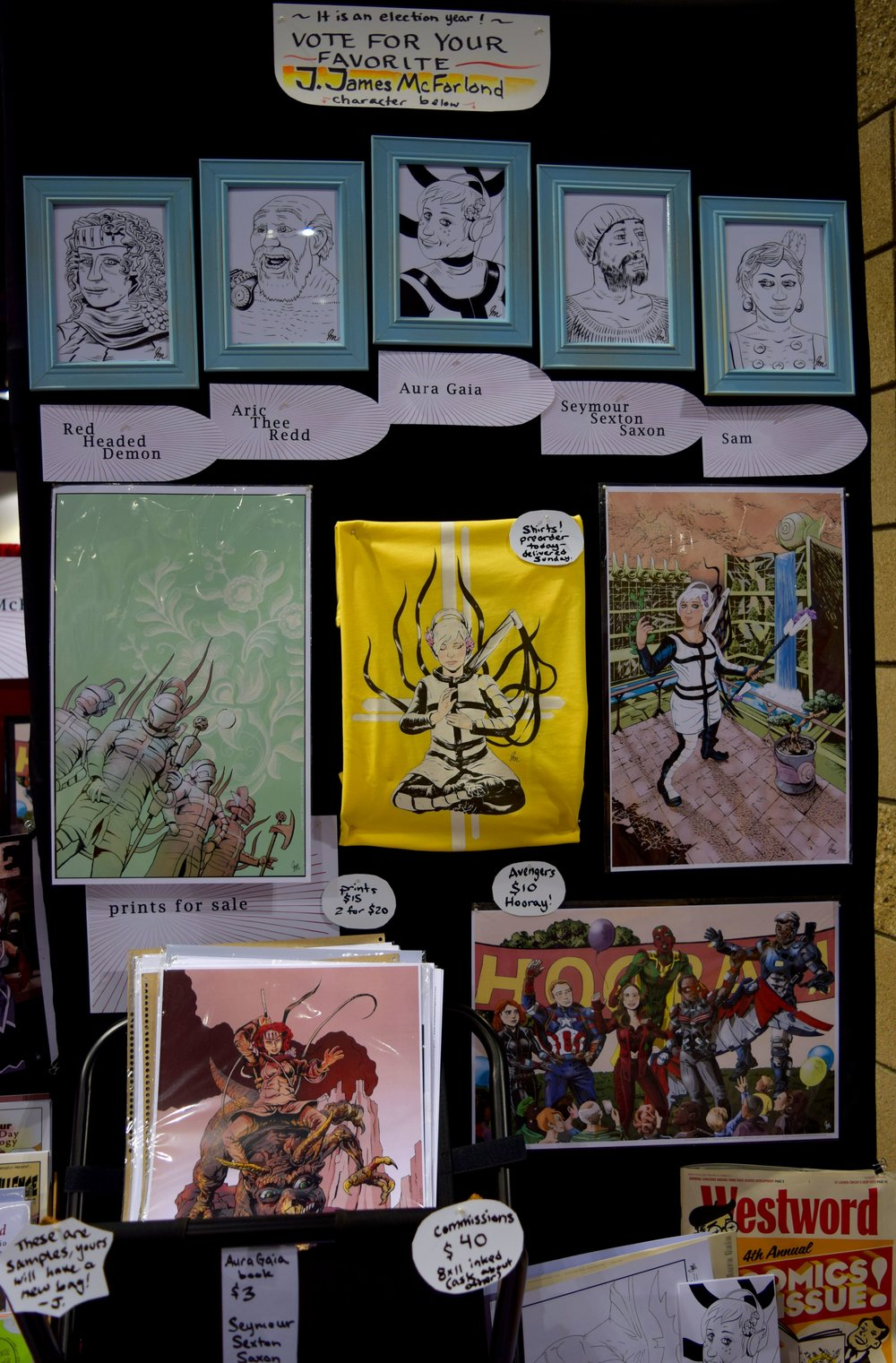 Prints and t-shirts from J. James McFarland at Denver Comic Con 2016.