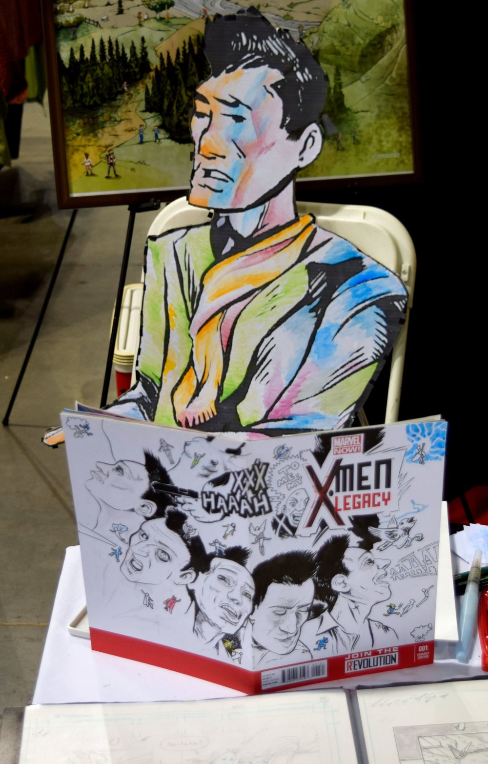 J. James McFarland convention stand-in with an X-Men: Legacy sketch cover.