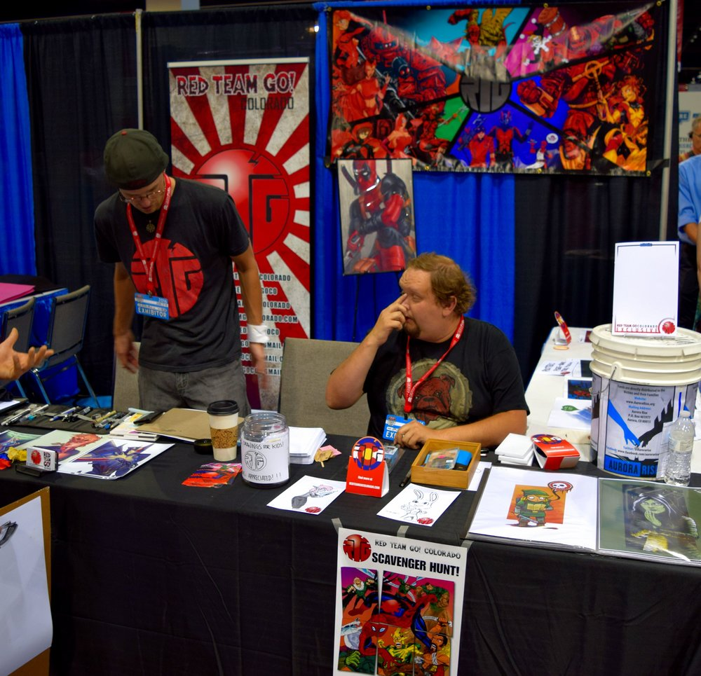 Colton Muheim & Cayen Sim of Red Team Go doing free sketches at Denver Comic Con 2016.