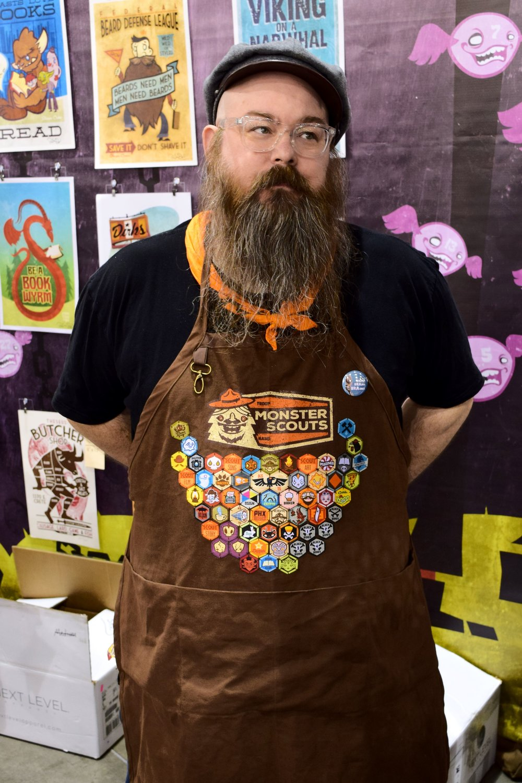 Daniel Monster Davis displays his Monster Scout badges at Phoenix Comic Con 2017.