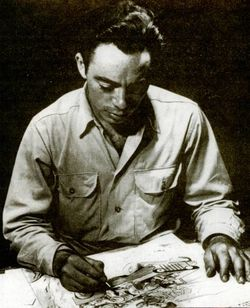Sheldon Moldoff sitting at his drawing table.