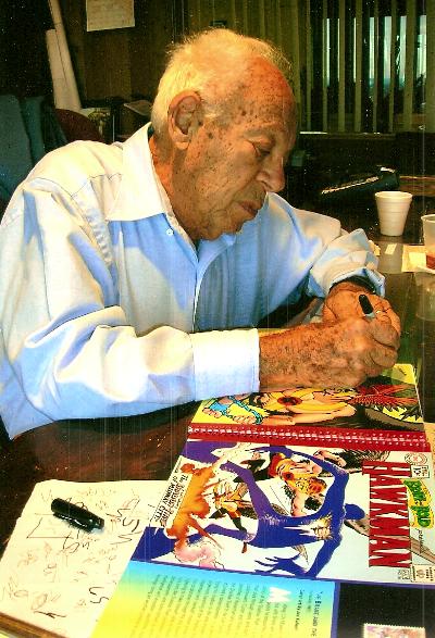 Sheldon Moldoff signing a book.