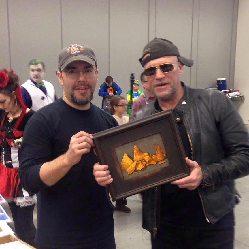 Clinton Hobart sells his Dorito painting to Michael Rooker at Wizard World Cleavland 2016.