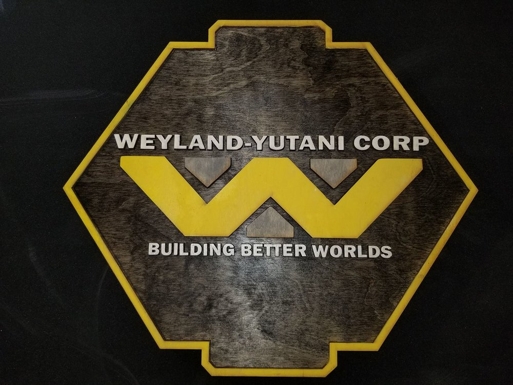 A Weyland-Yutani Corp placard from MacWolf Productions.