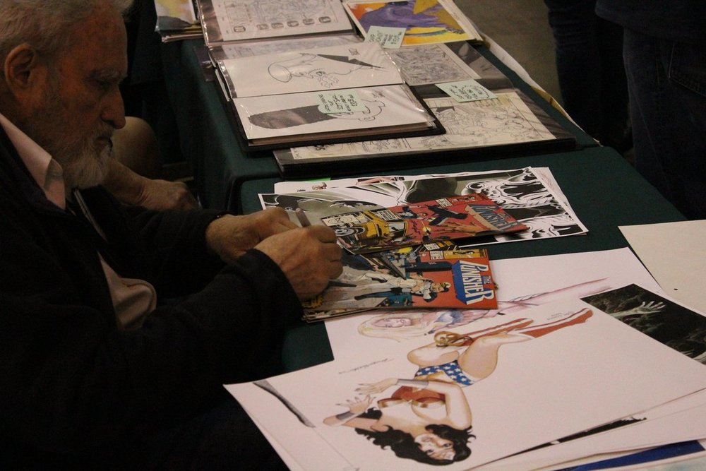 Russ Heath signing for the Hero Initiative in 2017.