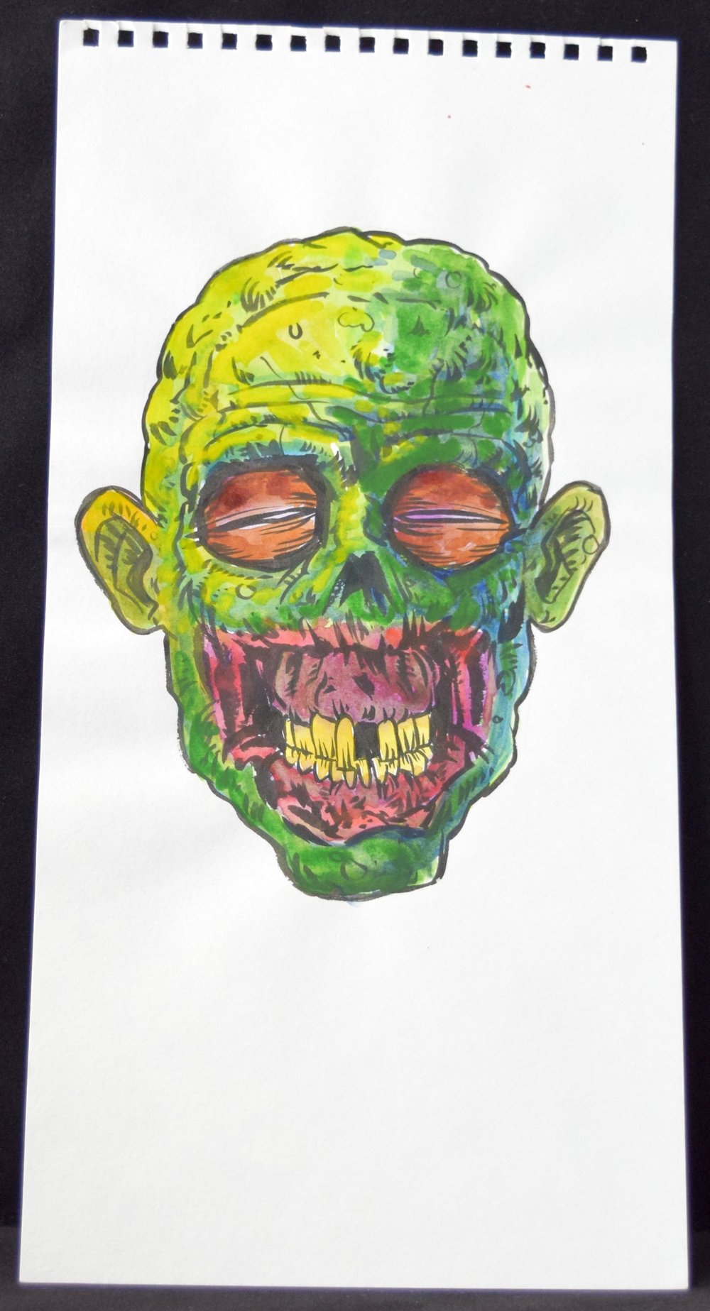A zombie head from  Joe Oliver .
