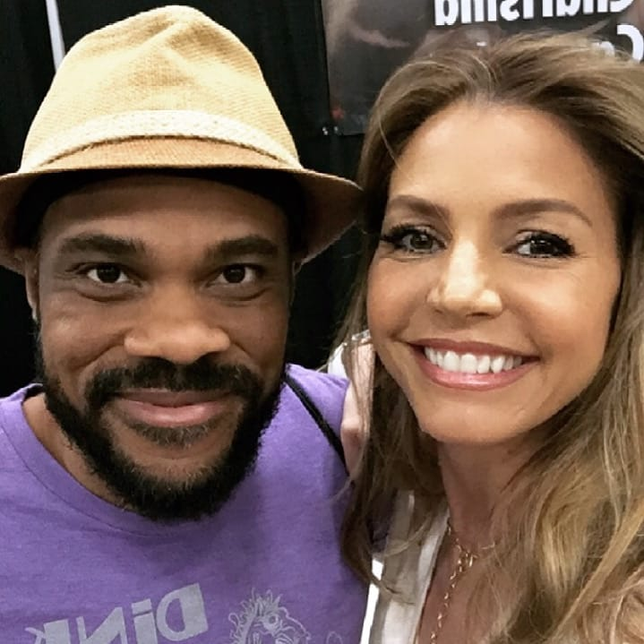 R. Alan Brooks  and  Charisma Carpenter  at Wizard World Des Moines 2018.