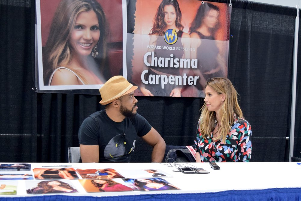 R. Alan Brooks  talks with  Charisma Carpenter  at Wizard World Des Moines 2018.