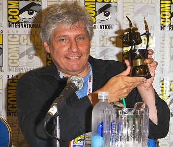 Elliot S! Maggin  holding his  Inkpot Award  at SDCC 2013.