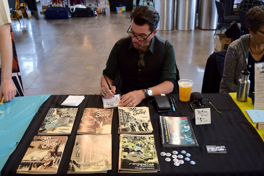 Karl Christian Krumpholz  making silly faces at  Denver Zine Fest 2018 .