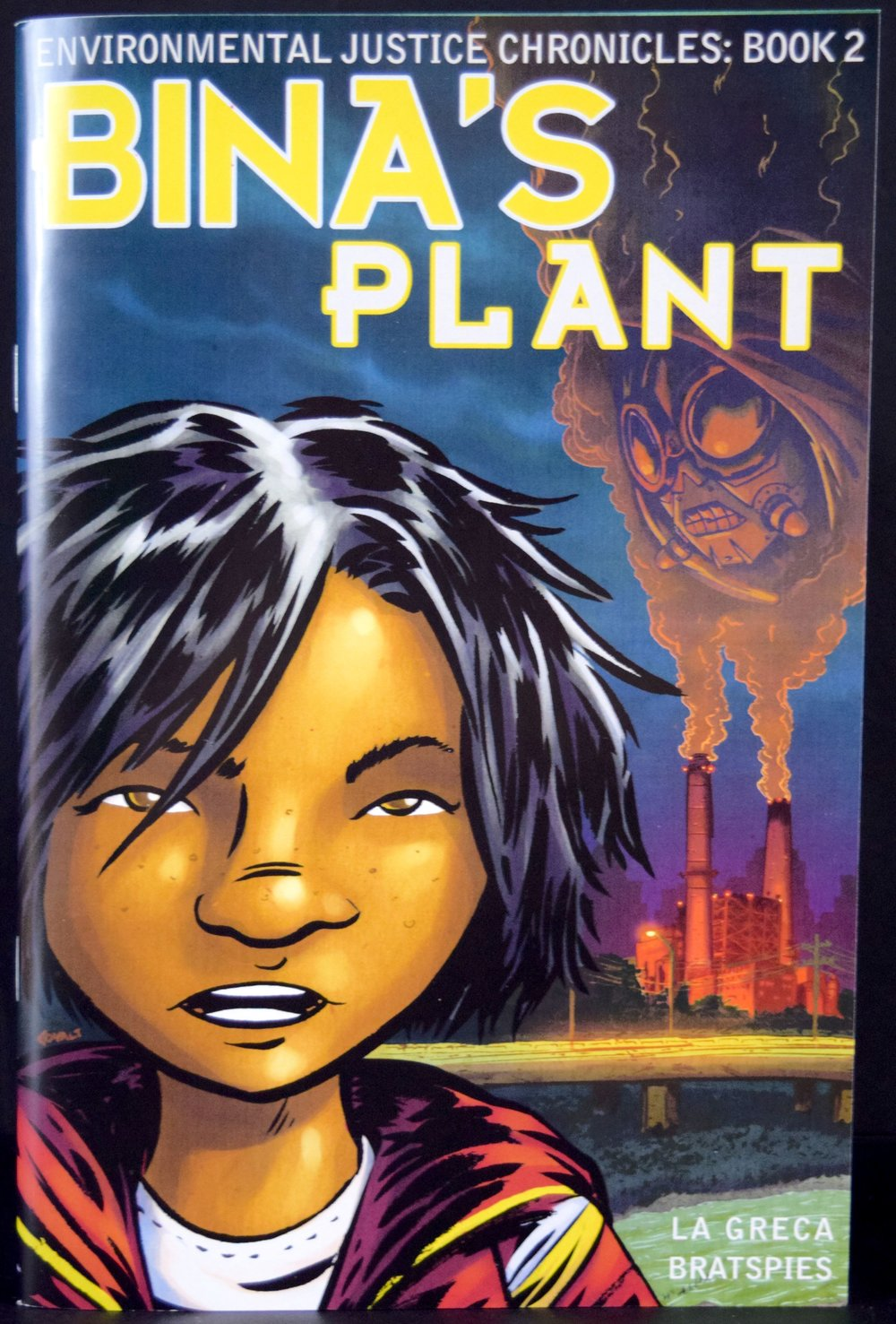 Environmental Justice Chronicles Book 2: Bina's Plant , written by  Charlie La Greca  &  Rebecca Bratspies  with art from  Charlie La Greca .