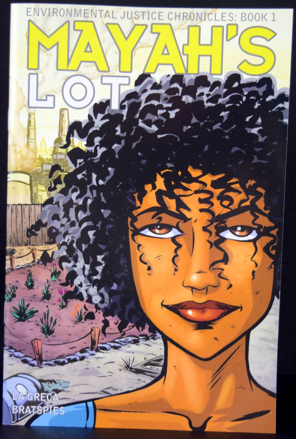 Environmental Justice Chronicles Book 1: Mayah's Lot,  written by  Charlie La Greca  &  Rebecca Bratspies  with art from  Charlie La Greca .