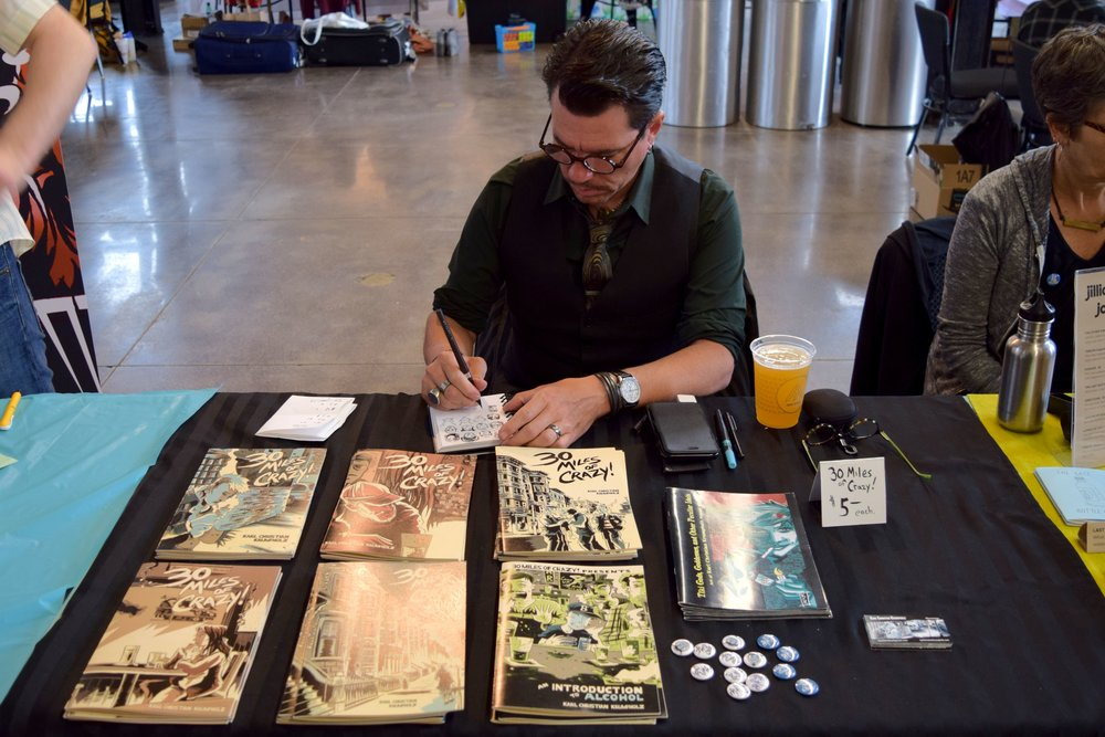 Karl Christian Krumpholz  drawing silly faces at  Denver Zine Fest 2018 .