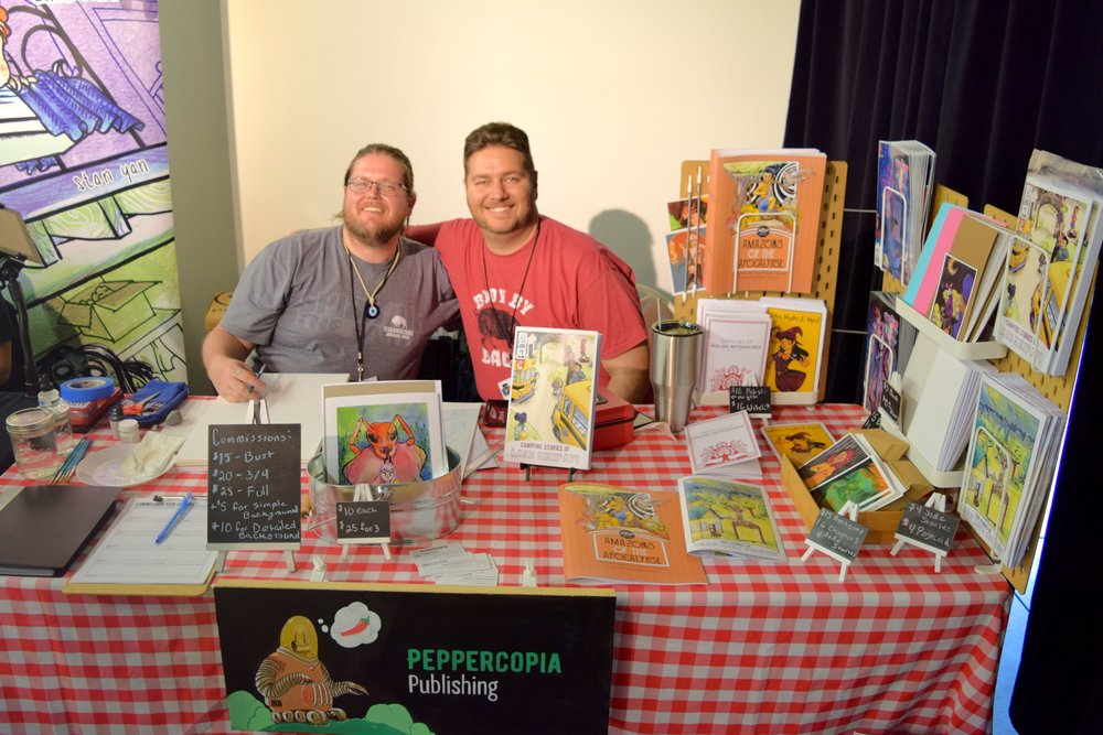 Pepper & Bill DeLuca behind their table at DINK 2018.