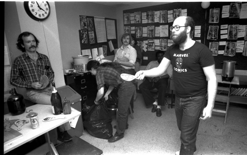 Al Milgrom (wearing his Marvel Comics shirt) playing paddleball in the Marvel offices, 1982.