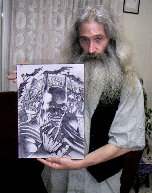 Mike Netzer, holding a Batman commission.