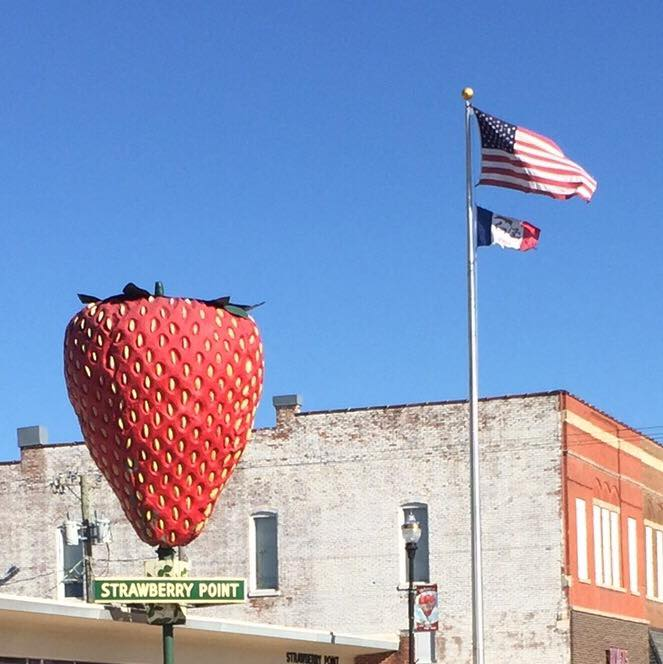 Strawberry Point, Iowa, with the biggest strawberry in the world and the best pie. Again, note the horizontal flag.