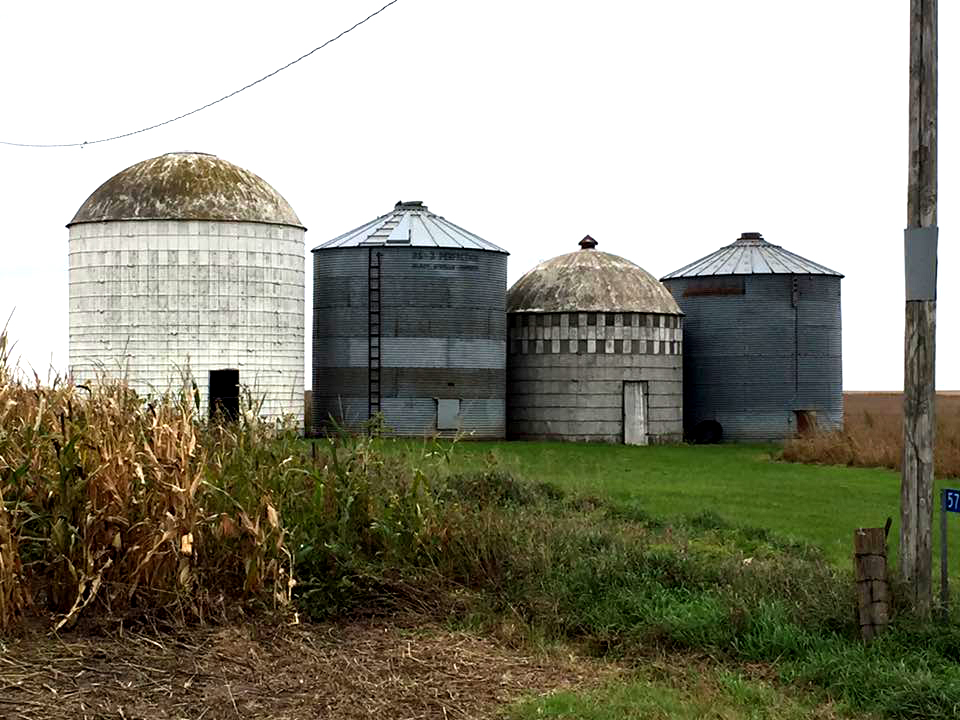 Four silos, all so different, sizes, shapes and patterns. Being an artist, I always wonder about who created the designs for these very functional buildings. They all hold harvested crops, and yet they each have their own look.