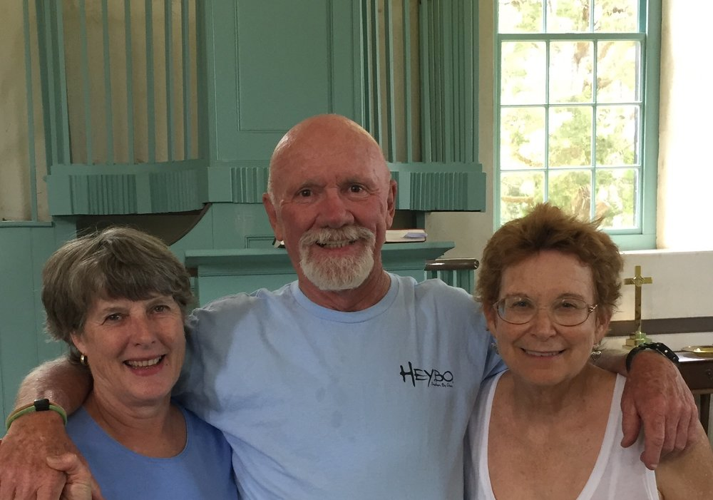 Isabella and Roger and Deb inside their historic church.    Roger loaded our bikes into their truck and invited us to spend the night. As we watched the thunderstorm pour down across the Rappahanack River behind their home, I was so grateful to be inside.