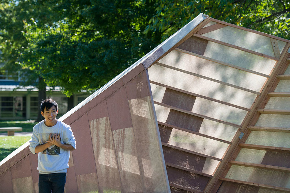 Sam Lai gives a poetry reading with  Surface to Sukkah  serving as the stage. Photo by Joe Angeles/WUSTL Photos.