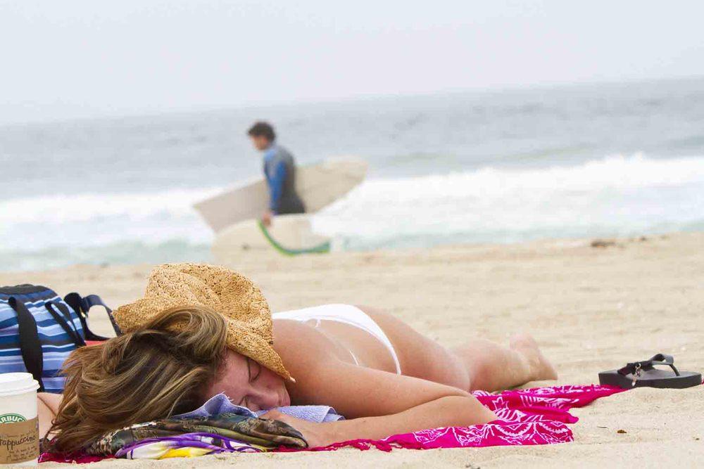 Girl Sleeping on Beach & Broken Surf Board.jpg