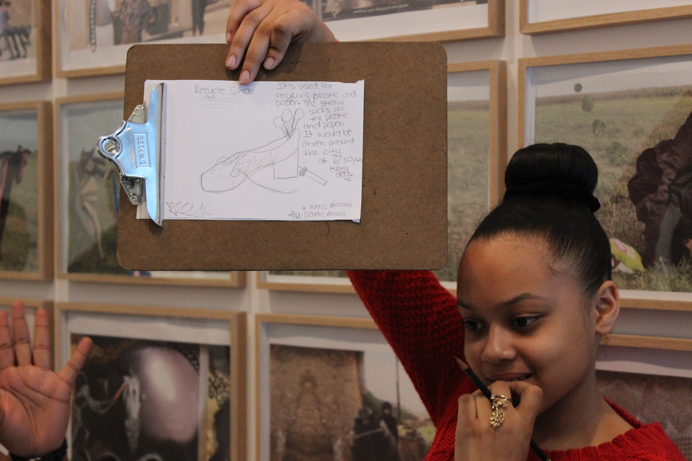 Here's a close up of her sketch that displays her invention to make the world a better place using objects found in the gallery.