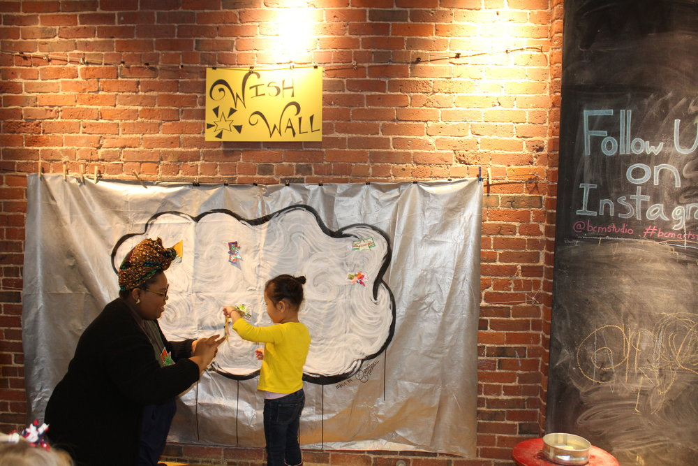 Helping out a little one during an art workshop I developed for The Children's Museum in Boston.