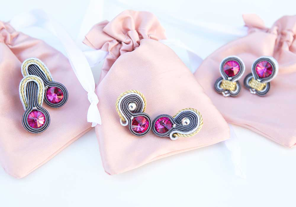 Unique earrings for each bridesmaid were created for this wedding.