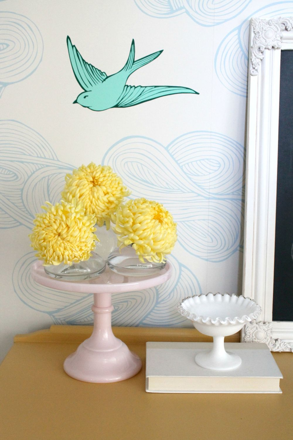 Cheery nook with wallpaper, bud vases, cake plate and ruffled bowl