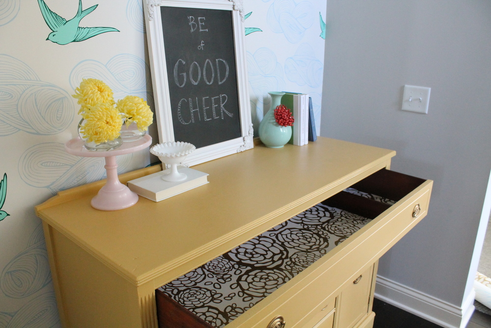 Yellow Sideboard with wallpapered drawers