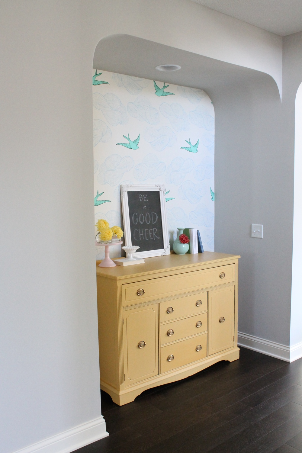 Cheerful Wallpapered Nook With Yellow Sideboard