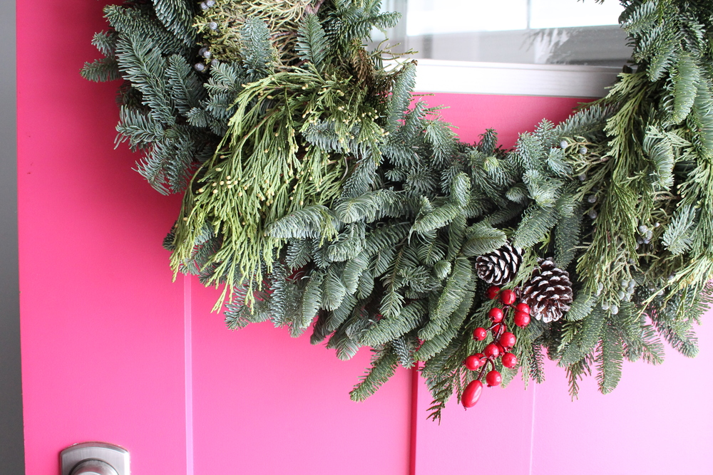 Pink Front Door with Evergreen Wreath