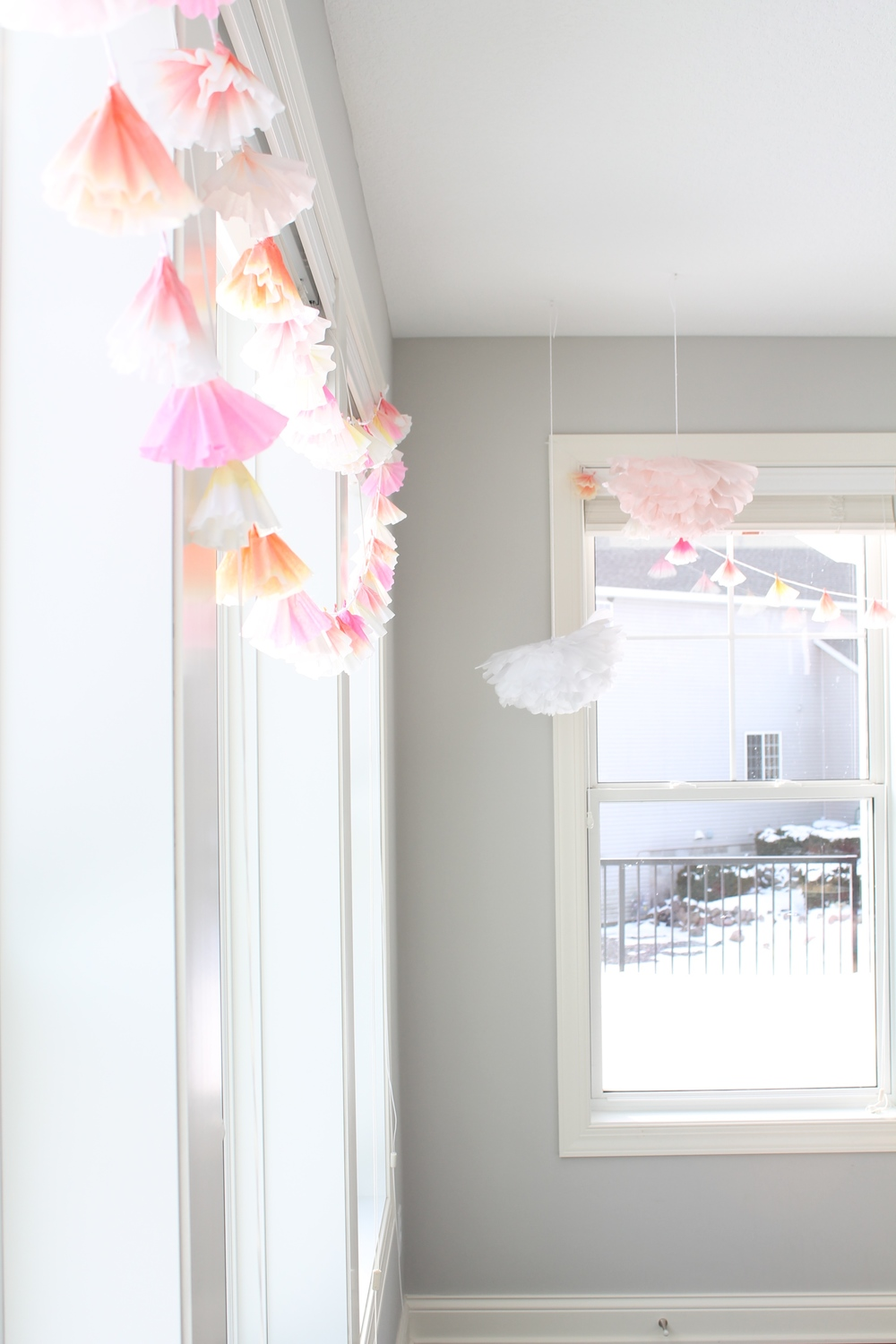 Coffee Filter garland and giant tissue paper flowers for the perfect garden tea party.